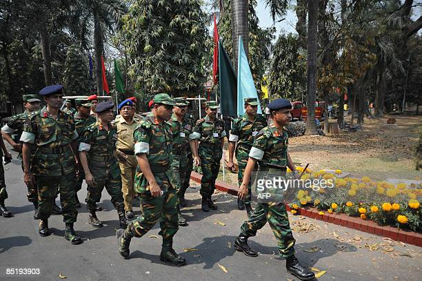A Bangladeshi Army investigation team arrives at the compounds of the Bangladesh Rifles headquarters in Dhaka on March 3 2009 The Bangladesh military...