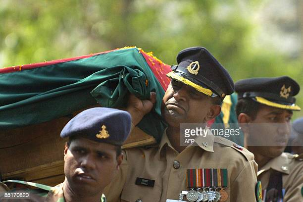 A Bangladeshi Army officer reacts as he carries the coffin of a comrade killed during a mutiny during a funeral ceremony in Dhaka on March 2 2009...