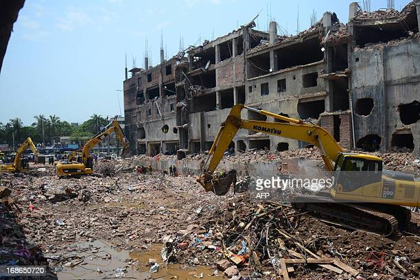 Bangladeshi Army personnel use heavy equipment as they continue to clear debris after an eight-storey building collapsed in Savar, on the outskirts...