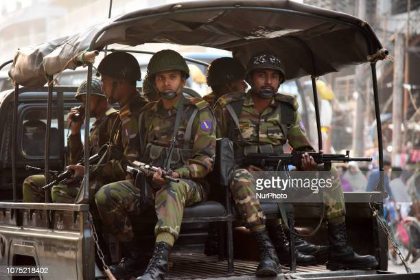Bangladeshi Army soldiers patrol in a Dhaka street ahead of National pulls election in Dhaka Bangladesh on December 27 2018 According to reports army...