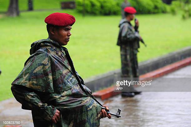 Bangladeshi army soldiers stand guard at the headquarter of the Bangladesh Rifles during session of a special mutiny court held on the compound in...