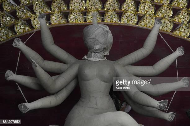 Bangladeshi artist prepares a clay idol of Hindu deity Durga at a workshop ahead of Durga puja festival in Dhaka Bangladesh on August 18 2017 The...