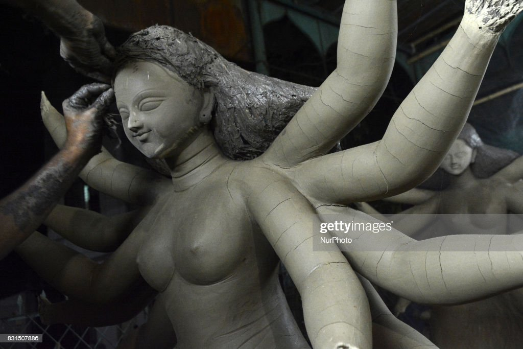 A Bangladeshi artist prepares a clay idol of Hindu deity Durga at a workshop ahead of Durga puja festival in Dhaka , Bangladesh on August 18, 2017. The annal five day Hindu festival begins on September 26 , 2017 and worship the goddess Durga , who symbolized power and the triumph of good over evil in Hindu Mythology.
