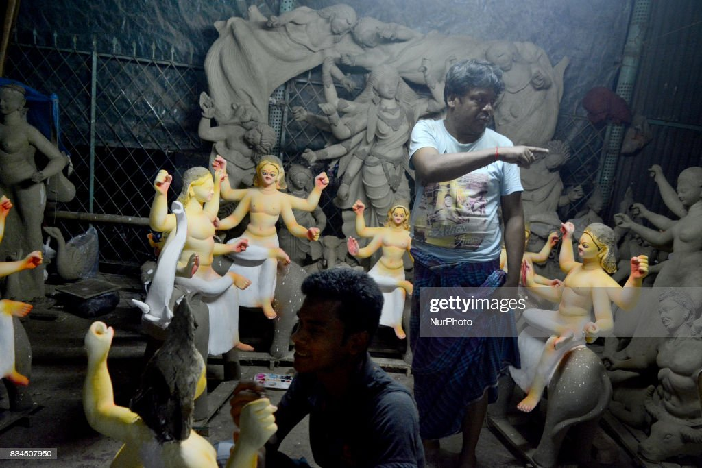 Bangladeshi artists preparing clay idol of Hindu deity Durga and God Biswakarma in Dhaka, Bangladesh on August 18 , 2017 for upcoming Hindu festival Durga puja and Biswakarma puja. The goddess Durga , who symbolized power and the triumph of good over evil in Hindu Mythology. Biswakarma is the Hindu god of architecture and machinery.