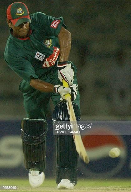Bangladeshi batsman Alok Kapali hits a boundary off Pakistani bowler Mohammad Hafeez during the fifth One Day International match between Pakistan...