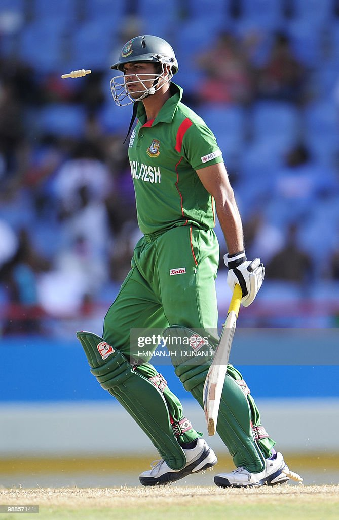 Bangladeshi batsman Mashrafe Mortaza is stumped by Pakistani wicketkeeper Kamran Akmal during the match Pakistan against Bangladesh at the Beausejour Cricket Ground during the first round of the 2010 ICC Twenty20 World Cup in Gros Islet, St Lucia, May 01, 2010. Pakistan won by 21 runs. AFP PHOTO/Emmanuel Dunand