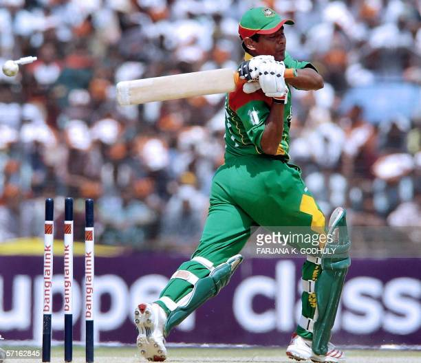 Bangladeshi batsman Mohammad Rafique is clean bowled by Kenyan spinner Jimmy Kamande during the third One Day International between Bangladesh and...