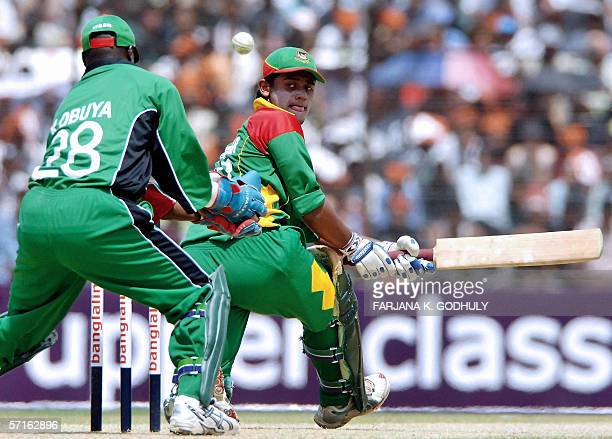 Bangladeshi batsman Shahriar Nafees looks back after hitting the ball to the boundary during the third One Day International between Bangladesh and...