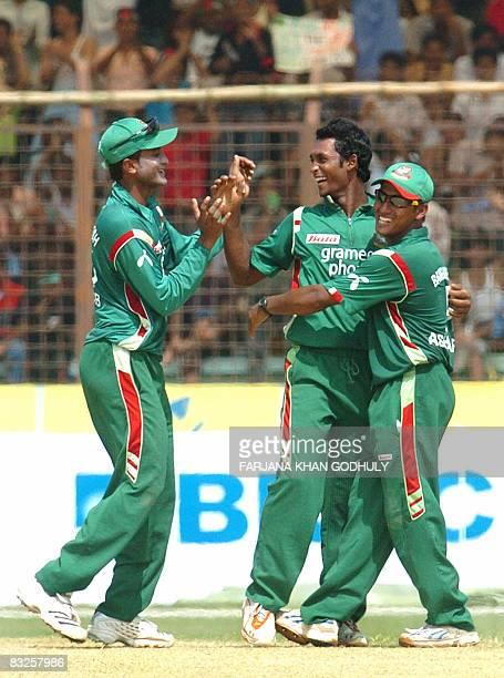 Bangladeshi bowler Nayeem Islam celebrates the wicket of New Zealand batsman Jamie How with team mates Sakib Al Hasan and Mushfiqur Rahim during the...