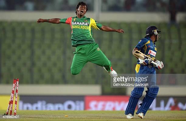 Bangladeshi bowler Rubel Hossain celebrates after running out Sri Lankan batsman Mahela Jayawardene during the tenth match of the Asia Cup oneday...