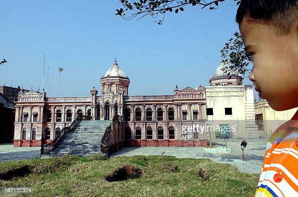 Bangladeshi boy looks at a replica of Ahsan Manzil palace once home to Dhaka's wealthiest landowners at the Concorde Heritage Park the country's...