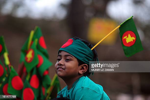 A Bangladeshi boy wearing a national flag on his head attends a rally demanding the death sentence for the country's war criminals in Dhaka on...