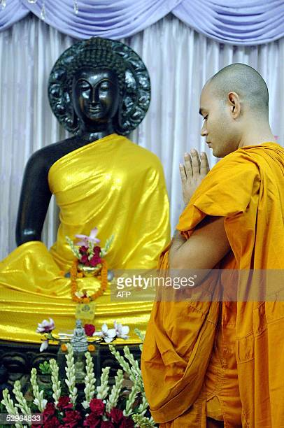 Bangladeshi Buddhist monk prays at a shrine to mark the anniversary of Buddha's birthday at a temple in Dhaka 22 May 2005 Wesak Day is one of the...
