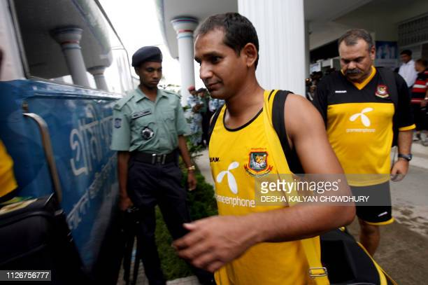 Bangladeshi captain Habibul Bashar and coach Dev Whatmore are watched by a police official as they board the team bus after a practice session at The...