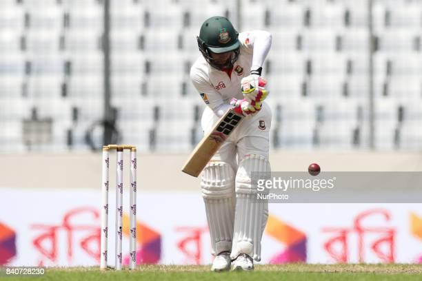 Bangladeshi Captain Mushfiqur Rahim plays a shot during day three of the First Test match between Bangladesh and Australia at Shere Bangla National...