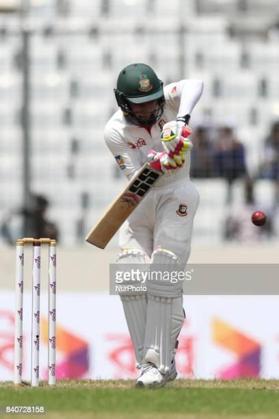 Bangladeshi Captain Mushfiqur Rahim plays a shot during the third day of the first Test cricket match between Bangladesh and Australia at the...