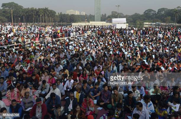Bangladeshi Catholic devotees gather ahead of a mass led by Pope Francis in Dhaka on December 1 2017 Pope Francis arrived in Bangladesh from Myanmar...