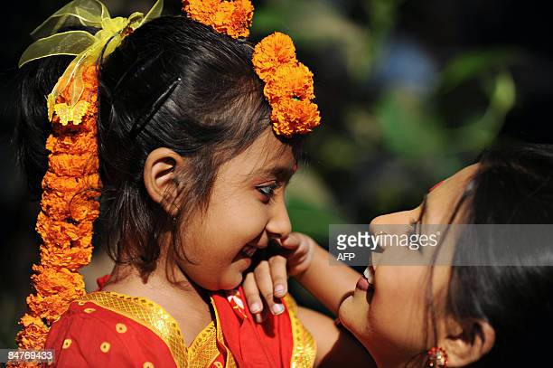 A Bangladeshi child and her mother interact as they attend the Boshonto Utshob festival in Dhaka on February 13 2009 The spring festival of Boshonto...