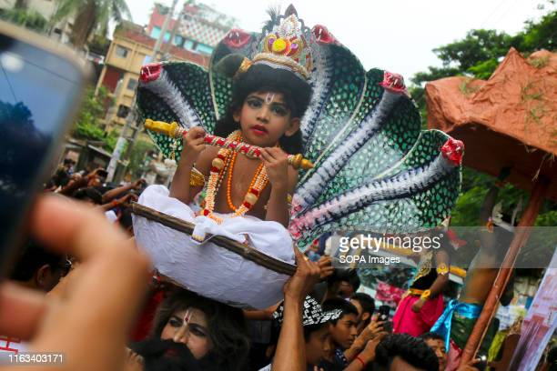 Bangladeshi child dressed as the Hindu God Krishna during the celebration Janmasthami is celebrated yearly as an annual commemoration of the birth of...
