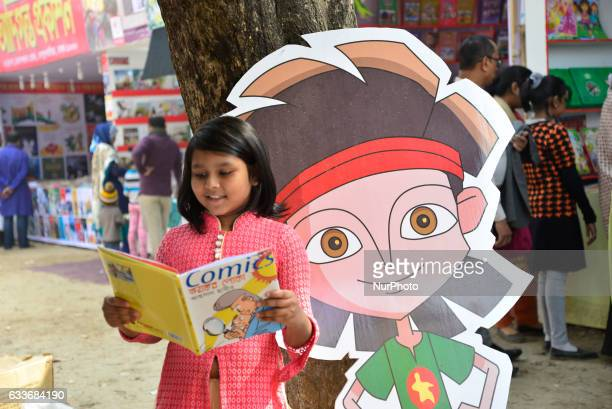 A Bangladeshi child shopper brows books at a stall during the country's largest book fair in Dhaka Bangladesh On February 03 2017 Bangladesh's...