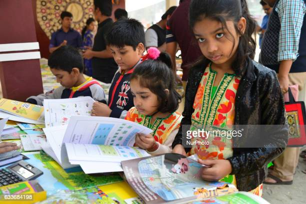 Bangladeshi child shoppers brows books at a stall during the country's largest book fair in Dhaka Bangladesh On February 03 2017 Bangladesh's largest...