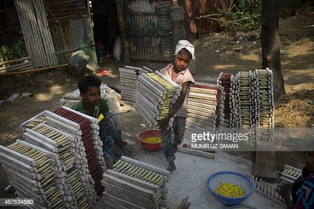 A Bangladeshi child works at balloon factory in Dhaka on October 20 2014 More than 63 million children under the age of 14 are working in Bangladesh...