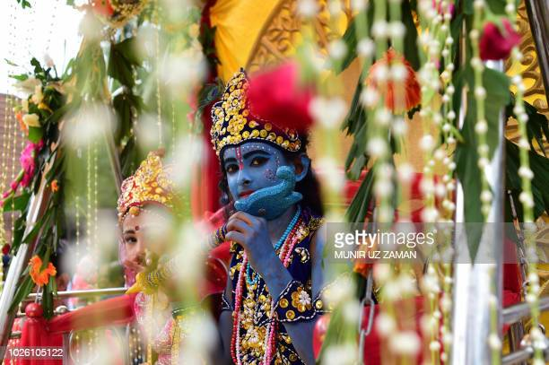 Bangladeshi children dressed as the Hindu god Lord Krishna and Radha take part in a procession during celebrations of Janmashtami festival in Dhaka...