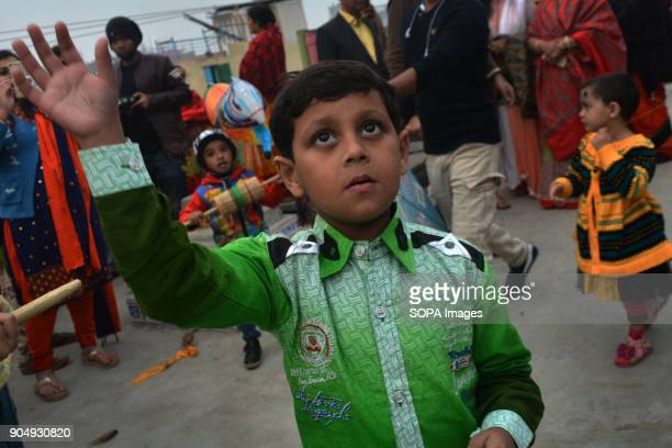 Bangladeshi children during kite flying at Shakrain Festival in southern part of the capital Dhaka BangladeshThe idea behind the festival is about...