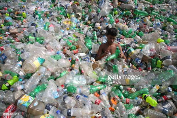 A Bangladeshi children works in a plastic bottle recycling factory in Dhaka on 16 September 2018 Bangladesh Recycling workers in Bangladesh one of...