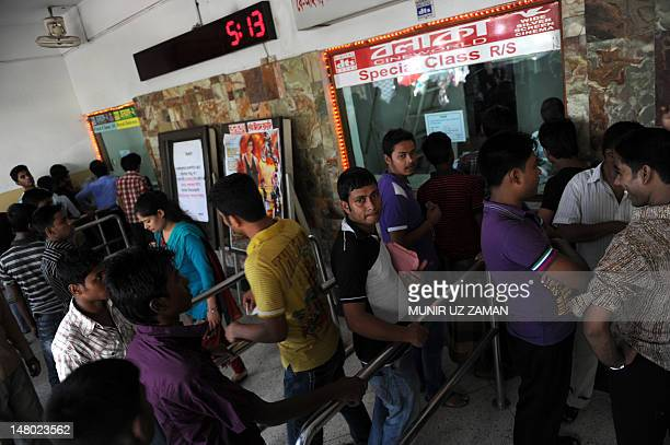 Bangladeshi cinema goers queue for tickets at a movie theatre in Dhaka on July 6 2012 A film about a love affair between a transgender person and a...