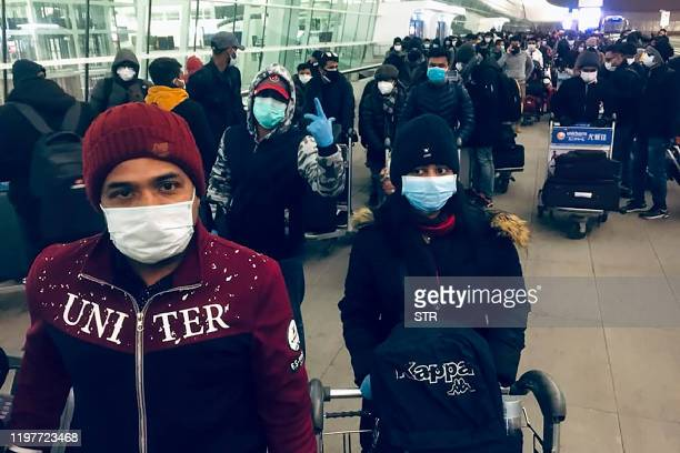 Bangladeshi citizens mostly students wearing facemasks wait at Wuhan airport on January 31 as the Bangladeshi government prepares to evacuate them...