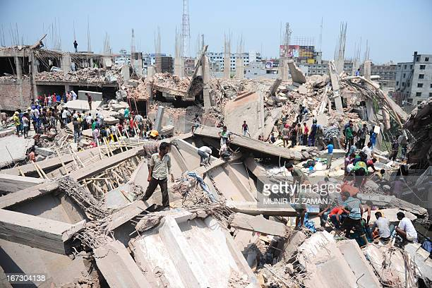 Bangladeshi civilian volunteers assist in rescue operations after an eightstorey building collapsed in Savar on the outskirts of Dhaka on April 24...