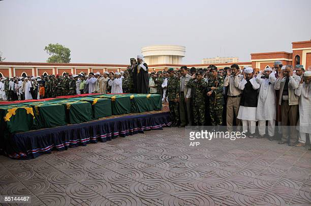 Bangladeshi civilians and army take part in a funeral of victims of the mutiny in Dhaka on February 27 two days after a fierce gun battle broke out...
