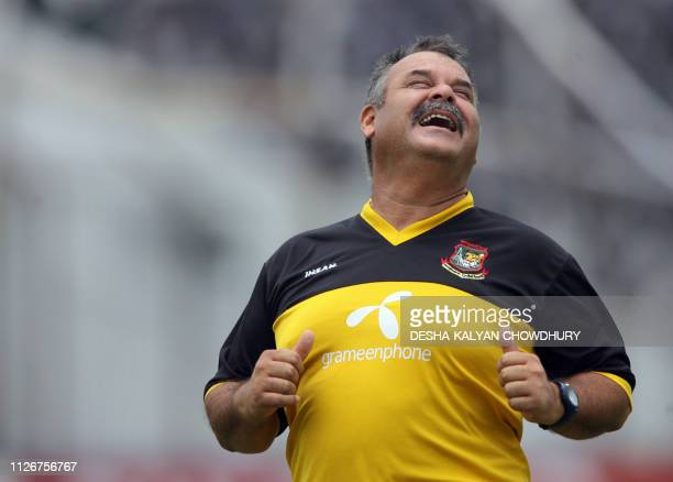 Bangladeshi coach Dev Whatmore gestures during a practice secession at the Ruhul Amin stadium in Chittagong 22 May 2007 Damp ground conditions after...