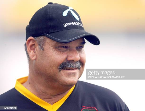 Bangladeshi coach Dev Whatmore looks on prior to the start of the first cricket Test match between Bangladesh and India at the Ruhul Amin Cricket...