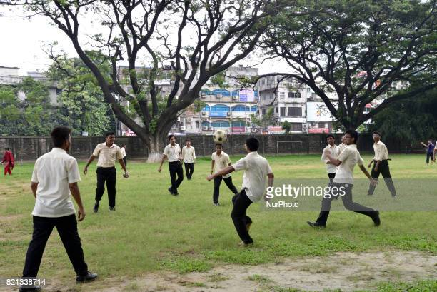 Bangladeshi collage students playing football on the collage ground at class break time in Dhaka city Bangladesh On July 23 2017
