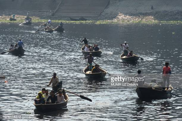 Bangladeshi commuters use boats to cross Buriganga river in Dhaka on December 31 a day after the country's general election Bangladesh Prime Minister...