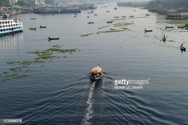 Bangladeshi commuters use boats to cross the Buriganga River in Dhaka on December 31 a day after the country's general election Bangladesh Prime...