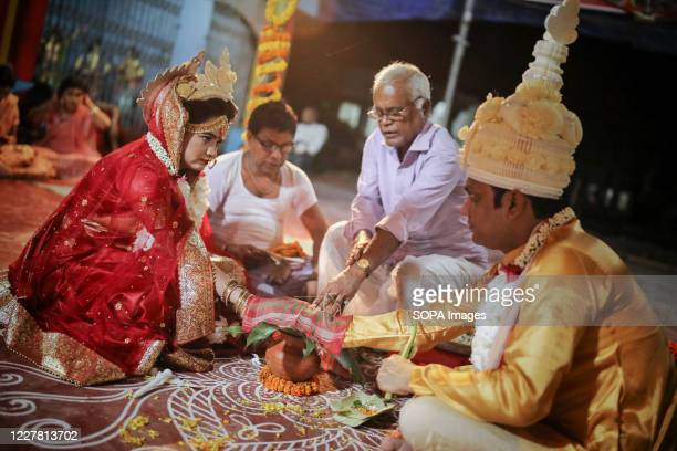 Bangladeshi couple perform wedding rituals according to Hindu traditions at the Ramna Temple in Dhaka. A Hindu wedding ceremony took place at a local...