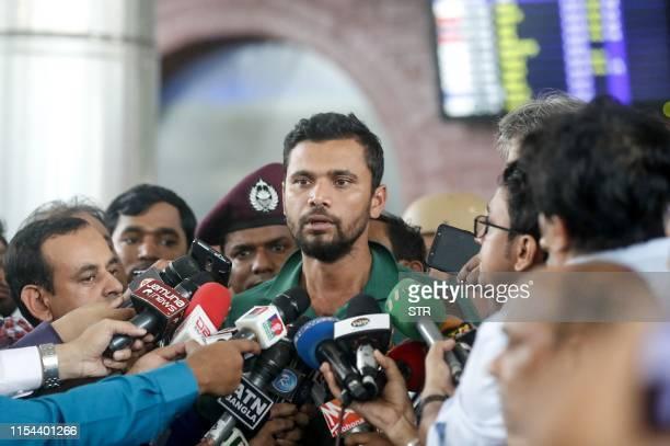 Bangladeshi cricket captain Mashrafe Bin Mortaza talks to journalists upon his arrival with his teammates at Hazrat Shahjalal International Airport...