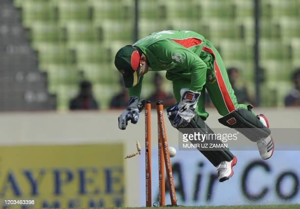 Bangladeshi cricket captain Mushfiqur Rahim attempts a run out of Pakistan batsman Mohammad Hafeez during the one day international Asia Cup cricket...