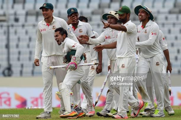 Bangladeshi cricket captain Mushfiqur Rahim celebrate after winning the first Test cricket match between Bangladesh and Australia at the ShereBangla...