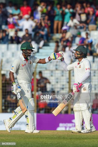 Bangladeshi cricket captain Mushfiqur Rahim with Sabbir Rahman after scoring a half century during the first day of the second cricket Test match...