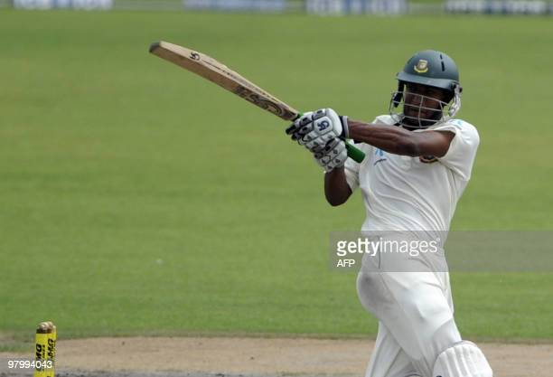 Bangladeshi cricket captain Shakib Al Hasan plays a shot during the fifth and last day of the second Test match between Bangladesh and England at the...