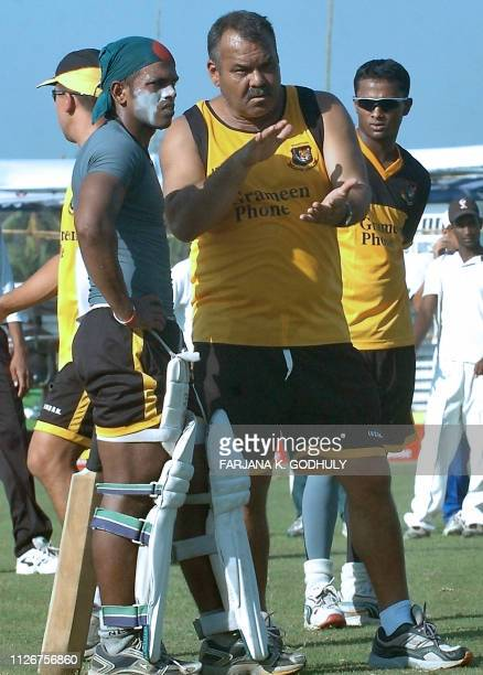 Bangladeshi cricket coach Dev Whatmore gestures as he speaks with cricketer Rajin Saleh as Enamul Haque looks on during a practice session at The Bir...