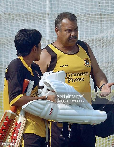 Bangladeshi cricket coach Dev Whatmore gestures as he speaks with cricketer Mushfiqur Rahim during a practice session at The Shahid Chadu Stadium in...
