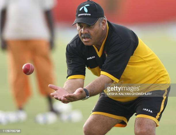 Bangladeshi cricket coach Dev Whatmore takes a catch during a net practice session at The Ruhul Amin Cricket Stadium in Chittagong 16 May 2007...