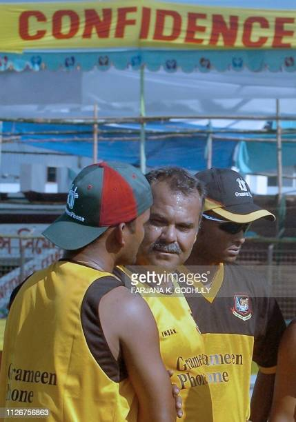 Bangladeshi cricket coach Dev Whatmore talks with team's fielding coach Salauddin as cricketer Enamul Haque looks on during a practice at Bir...
