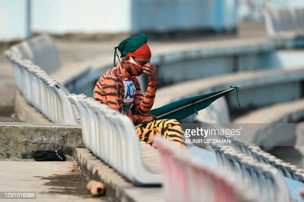 Bangladeshi cricket fan dressed with a tiger custome reacts during the fifth day of the first cricket Test match between Bangladesh and West Indies...
