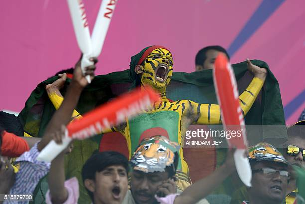 A Bangladeshi cricket fan in body paint shouts in support of the team during the World T20 match between Pakistan and Bangladesh at Eden Gardens in...